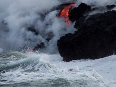 Waves lap at the encroaching lava