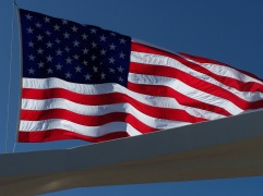Flag flying in the warm breeze over the Pearl Harbor Memorial, Hawaii