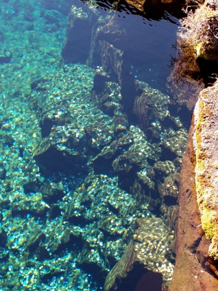 Thousands of króna seen through crystal clear water