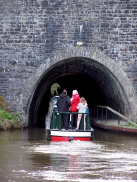 Navigating a narrowboat through the tunnel