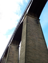 Canal boats glide high across Pontcysyllte Aqueduct, 126 feet above the River Dee in Northern Wales