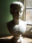 A bust illuminated by the sun's rays.