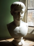 A bust illuminated by the sun's rays.