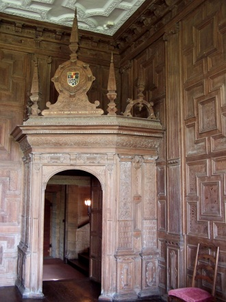 Elaborately carved paneling in the 14th century Oak Room of Broughton Castle, Banbury, England.
