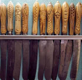 A collection of wooden handled bread knives...the wear on the handles tells just how much they were used.