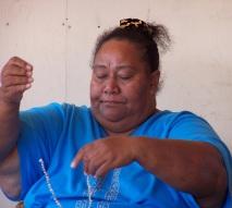 Stringing a shell necklace, Honolulu, Hawaii