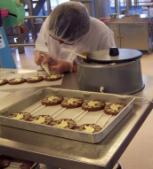 Decorating chocolate lollies, Cadbury Factory, Birmingham, England