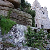 The castle peeks out from its rocky perch.