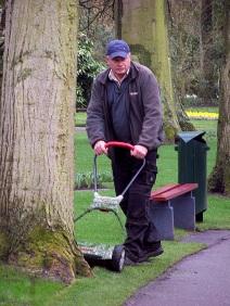Manicuring the lawn at Keukenhof Gardens, Lisse, Netherlands