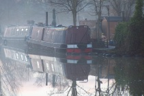 Narrowboats on a foggy morning.