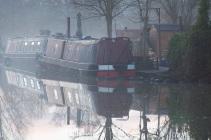 Narrowboats on a foggy morning.